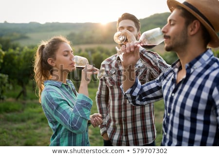 Stock photo: couple tasting wine at a vineyard