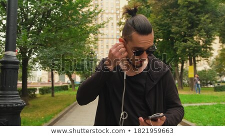 Man with stubble putting his glasses on his head Stock photo © photography33