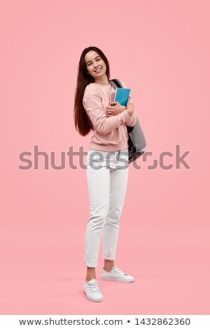 School girl standing with notebooks stock photo © stockyimages