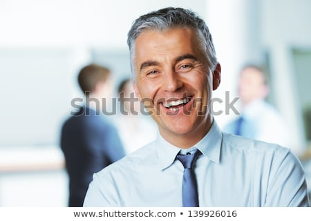 Stock photo: Portrait of Smiling Attractive Middle Age Business Man