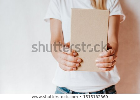 Delivery person holding packages Stock photo © Ariwasabi