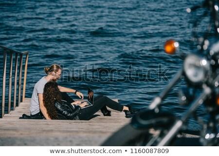 Travel destination. Man and woman resting near motorbike Stock photo © gromovataya