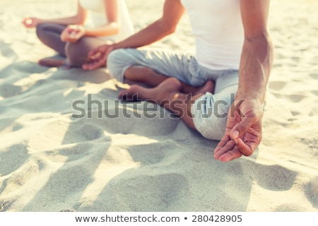 Beach Yoga with young couple - closup stock photo © Schmedia