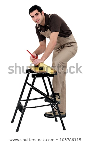 carpenter making measurements with pencil on lumber strip against studio background Stock photo © photography33