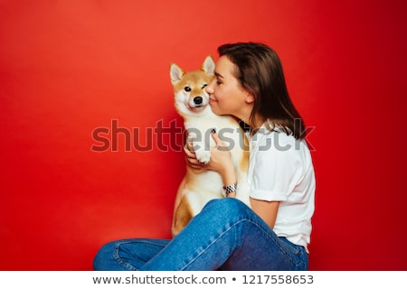 playful young brunette in a red jeans stock photo © acidgrey