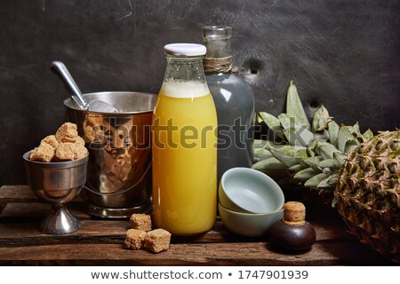 pineapple next to pineapple juice stock photo © photography33