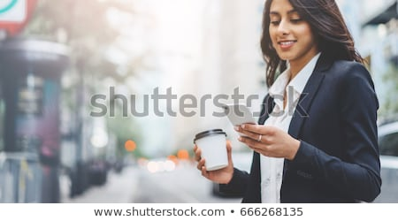 smiling business woman with phone receiver stock photo © photosebia