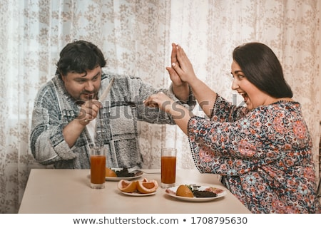 Woman trying to persuade her husband Stock photo © photography33
