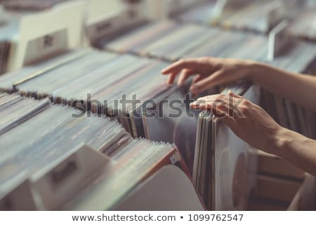 Girl with vinyl disc Stock photo © kalozzolak