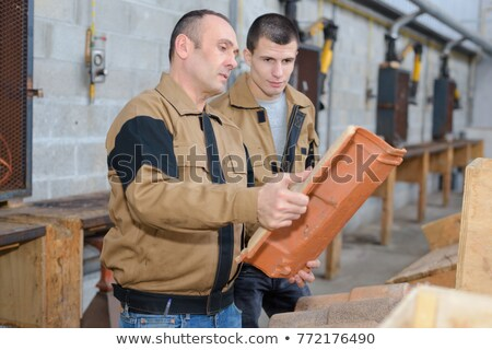 builder holding stack of roof tiles stock photo © photography33
