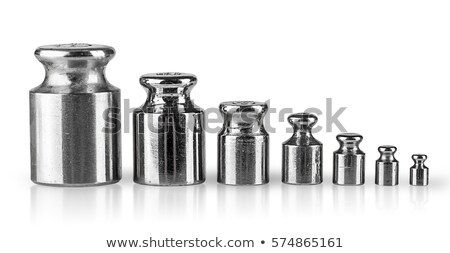 Row of calibration weights isolated on white. Stock photo © lenapix