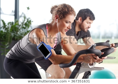 Aerobics spinning woman exercise workout at gym Stock photo © lunamarina