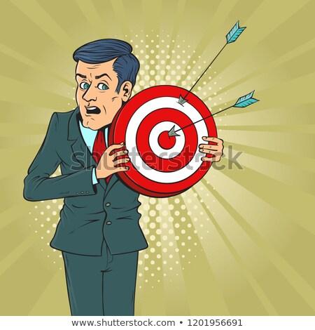 Businessman scared metaphor with target stock photo © lunamarina