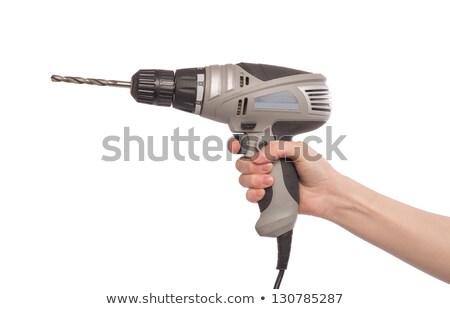 young woman holding a power tool stock photo © dukibu