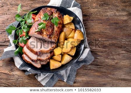 Gegrild varkensvlees lendenen plantaardige mosterd saus Stockfoto © hanusst