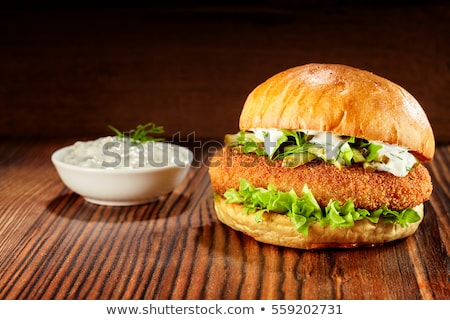 Burger with golden crumbed chicken breast Stock photo © juniart