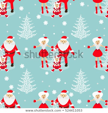 Mrs. Santa with Christmas decorations and abstract blue snowflak Stock photo © Nejron