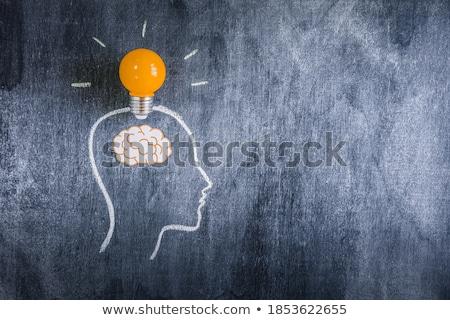 light bulb sign with brain over black background Stock photo © marinini