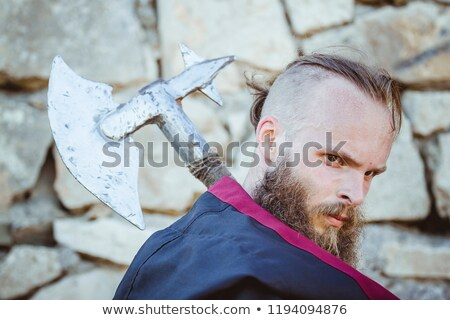 medieval knight with a sword against stone wall stock photo © nejron