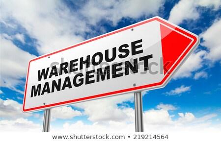 warehouse management on red road sign stock photo © tashatuvango