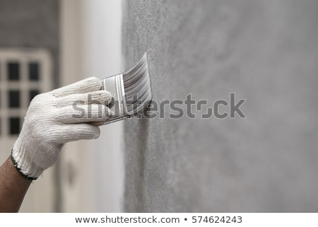 Painter with brush and paint on construction site Stock photo © Kzenon