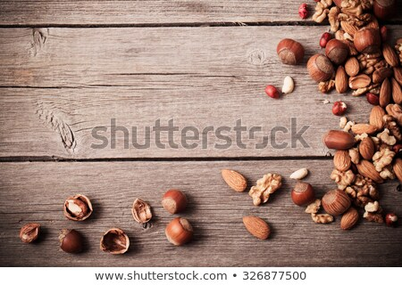 mixed nuts frame a wooden background stock photo © sarahdoow