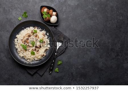 Risotto champignon maaltijd granen kom kruid Stockfoto © M-studio