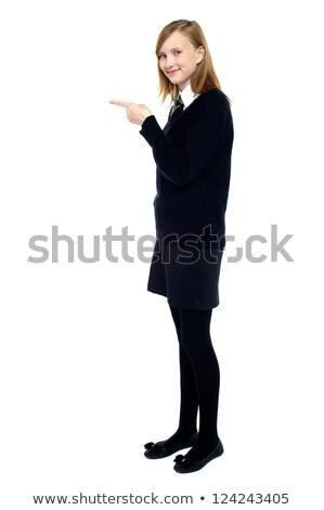Stylish teen girl indicating forward Stock photo © stockyimages
