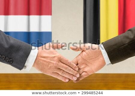 Representatives of the Netherlands and Belgium shake hands Stock photo © Zerbor
