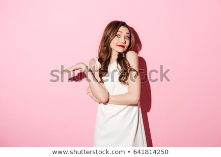 attractive woman shrugging shoulders stock photo © deandrobot