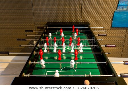 Miniature plastic soccer ball on wooden table Stock photo © stevanovicigor