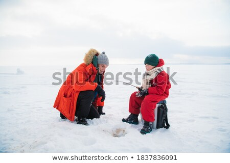 Two children and fisherman on frozen river Stock photo © Paha_L