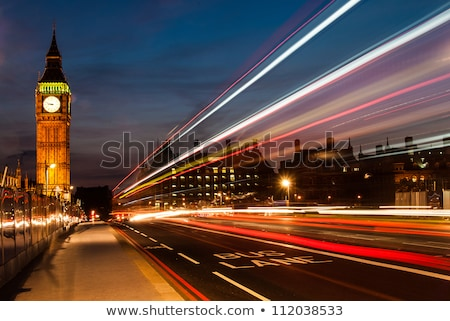 big ben at night with the lights of the cars passing stock photo © chris2766