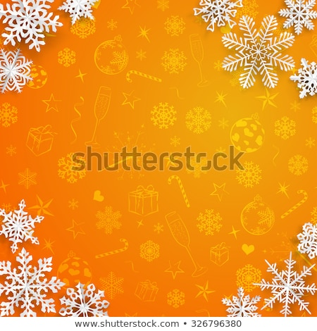 Christmas background with snowflakes cut out of paper on orange background of Christmas symbols Stock photo © rommeo79