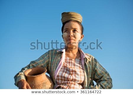 традиционный · фермер · портрет · завода · улыбка - Сток-фото © szefei