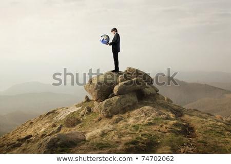 üzletember · kő · hegy · földgömb · áll · perem - stock fotó © ra2studio
