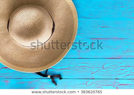 Wide brimmed straw gardening hat on a picnic table Stock photo © ozgur