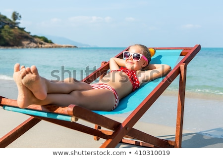 little · girl · banhos · de · sol · praia · bonitinho · sorrir · cara - foto stock © gregorydean