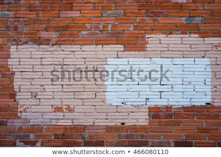Graffiti removal with white paint over covering on brick wall Stock photo © stevanovicigor