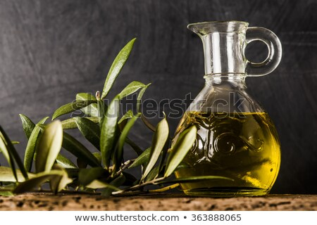 extra virgin olive oil in vintage glass oil jar stock photo © marimorena
