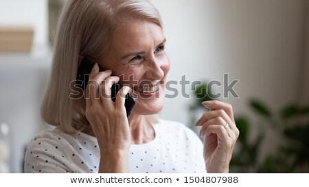 közelkép · boldog · barátok · okostelefonok · otthon · barátság - stock fotó © dolgachov