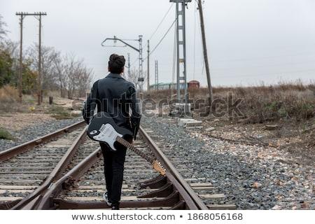 Biegun człowiek okulary spaceru widok z boku Zdjęcia stock © feedough