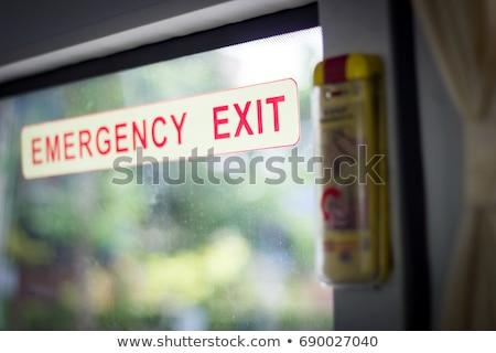 Emergência sair ônibus assinar janela sinal de saída Foto stock © suerob