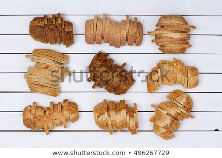 Nine loaves of bread sliced in staggered formation Stock photo © ozgur