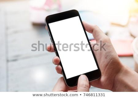 moço · telefone · móvel · branco · sms · sorrir · telefone - foto stock © cozyta