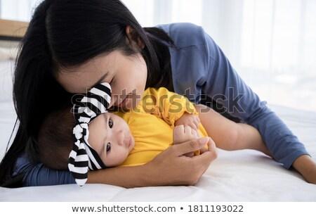 Сток-фото: красивой · матери · ребенка · кровать · мамы