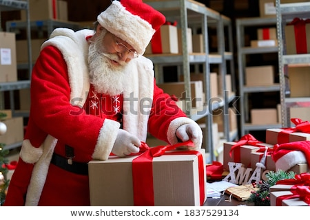 Santa Claus deliver a gift to a child Stock photo © alphaspirit