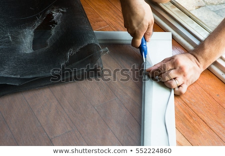 Man replacing ripped old patio door screen Stock photo © ozgur