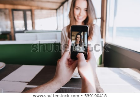 First-person view of man making photo his woman Stock photo © deandrobot