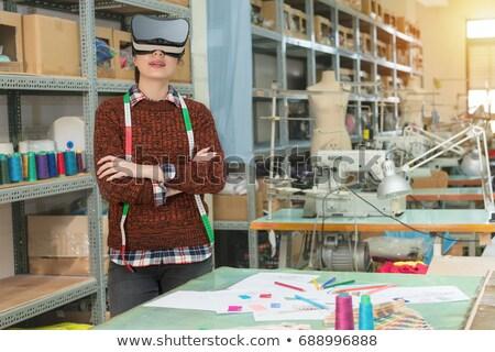Female tailor in VR headset Stock photo © dash
